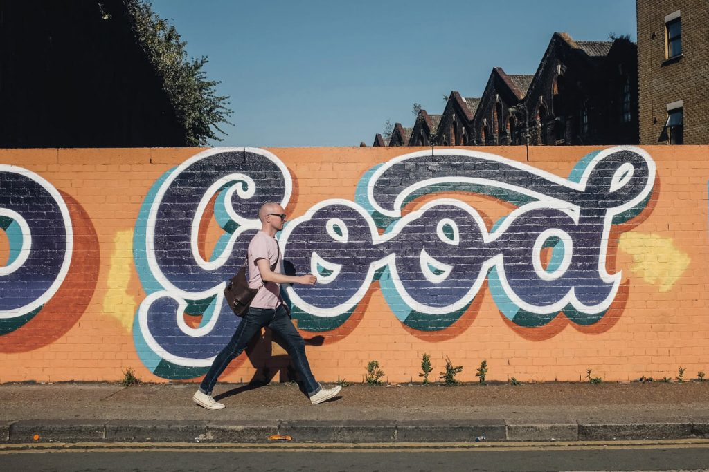 "Excellent.org focuses on the relevance of a good customer experience for customer retention and new customer acquisition. The picture shows a man walking past a graffiti lettering ""Good"