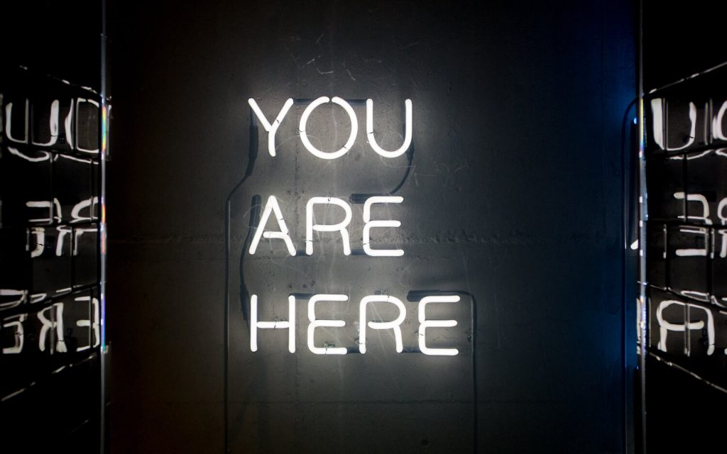 "Excellent.org explains the principles for good online store navigation and gives tips, the picture shows the luminous inscription ""You Are Here"""